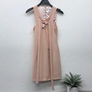 Sleeveless blush dress designed in Australia